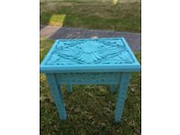 Small wooden carved side table