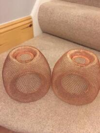 Two copper light shades