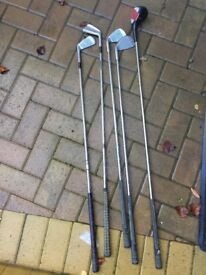 5 golf clubs (driver, 2,3,7 and 9 irons) in bag with 10 golf balls