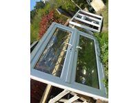 Double glazed white UPVC diamond leaded french windows and 3 panel window