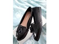 Womens black patent flat shoes. Small size 6. More like a 5.