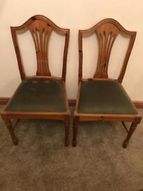 Pair of solid pine dining chairs