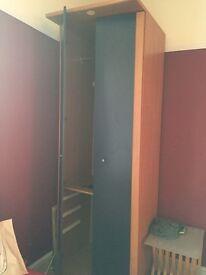 Tall. Blue IKEA wardrobe. Needs dismantling.