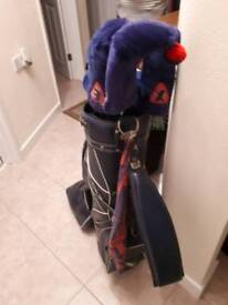 Set of golf clubs bag and trolley