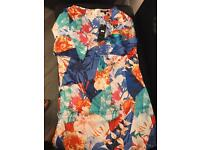 Ladies summer dress with sleeves size 12/14 new with tags.