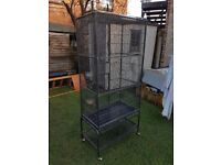 Large bird cage on wheel stand