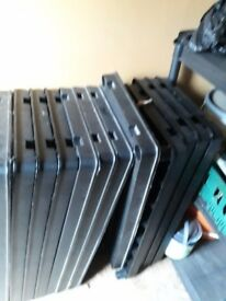 Black plastic shelfs , 12 shelfs with all legs.