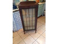 Old glass fronted wooden display cabinet