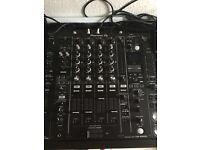 Pair of Pioneer CDJ-2000NXS2 with DJM-900NX2 mixer.