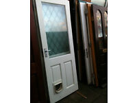 Exterior door with double glazed frosted glass and catflap