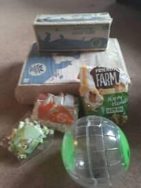 Hamster wood shavings, food, running globe plus other bits.