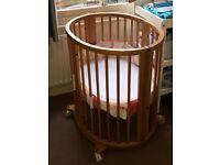 Stokke mini cot.The unique oval mini cot, a cozy for your newborn baby Stokke® Sleepi™ Mini