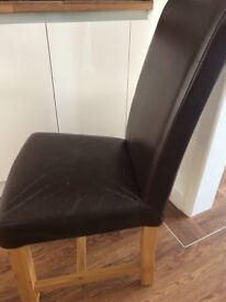 Originally NEXT 2 identical faux brown leather dining chairs