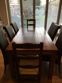 Solid wood extendable table and 8 chairs