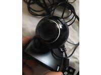 Computer web cam and headphones