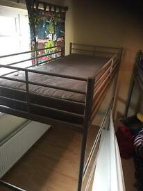 High metal bed with desk
