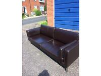 Brown leather settee
