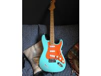 Fender stratocaster, Warmoth V neck, lace holy grail pickups and solid walnut body.