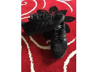 Men's black adidas trainers in size 10