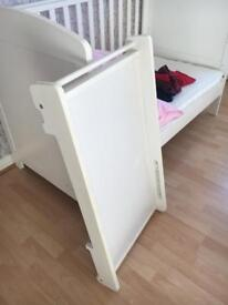 White cot bed and changing attachment