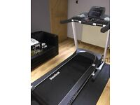 REEBOK TT1.0S TITANIUM TREADMILL - LIKE NEW ONLY USED HALF DOZEN TIMES, STILL UNDER WARRANTY