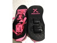Girls size 2 Black and pink Heelys, great condition.