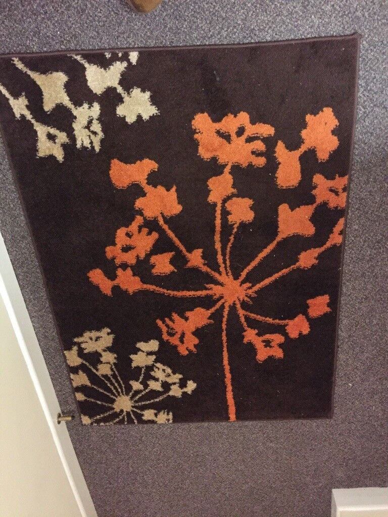Medium size brown floral rug, open to offers