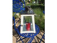 Garden Lantern For Sale. Steel and Glass. Has a little white wooden door.