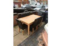 Lovely solid dining table with 6 leather chairs
