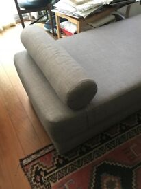 Attractive, simple, modern grey daybed which fold down into double sofa bed.