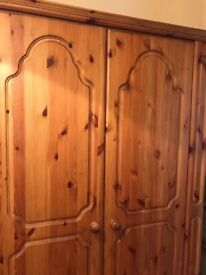 Solid wood wardrobe for sale . Really good condition with 2 draws at the bottom , oak colour