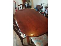 Big wood table with 6 chairs