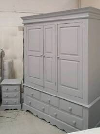 Solid pine Tripple door wardrobe and match bedside set if draws Delivery available