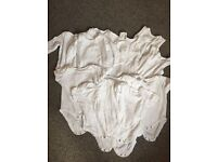 White baby vests and sleepsuit