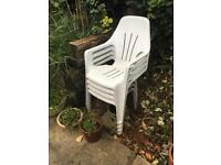 4 plastic white garden chairs