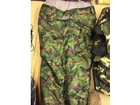Camouflage sleeping bag and hold-all