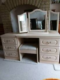 Full set of matching cream bedroom furniture, good clean condition, with stool and mirror.
