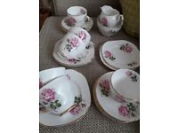 Vintage china tea set. 1954 White and pink rose pattern. 6 of each.