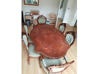 Italian style dining table with 4 matching chairs and 2 matching carver chairs.
