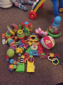 Baby toy bundle includes Lamaze rattles