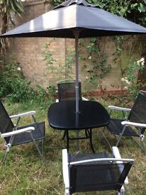 Garden table,4 chairs and a parasol