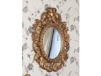 Ornate rococo hand carved oval gold mirror