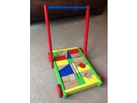 Lovely wooden baby walker with colourful bricks