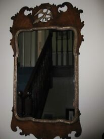 Antique mirror with shaped frame in walnut with gilding & inset Ho Ho bird figure.