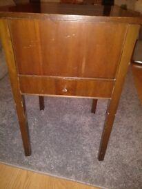 Antique walnut veneer sewing table.