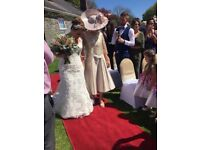 Beautiful champagne/gold mother of the bride outfit with hat