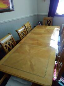 Solid wood dining table and 8 chairs