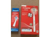 ( New and sealed ) Colgate ProClinical 350 Rechargeable Electric Toothbrush with 4 refills