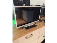 White 24' LCD TV, two HDMI sockets, built in DVD player, internet and netflix