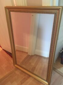 Mirror with a gold frame